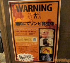"""Translation: """"Warning! There is a zombie outbreak in this building!"""""""