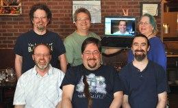 Meet the staff: (Back) J. Spyder Isaacson, Chris Nilsson, Eric Gjovaag, Cate Siguenza. (Front) Steve Jensen, Shawn Marier, Scott Surber.